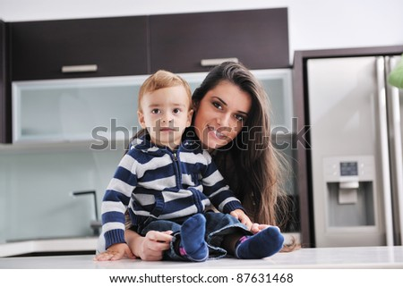portrait of a happy mom and son together in modern living room home indoor
