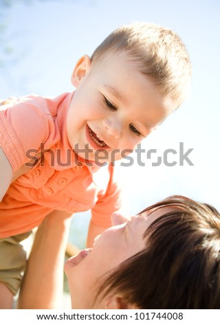 Portrait of a happy mother with her son outdoors