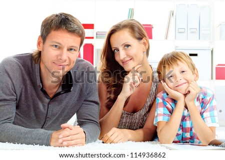 Portrait of a happy parents with their son together at home.