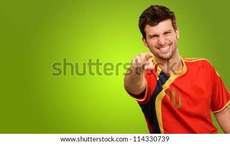 Portrait Of A Happy Player On Green Background