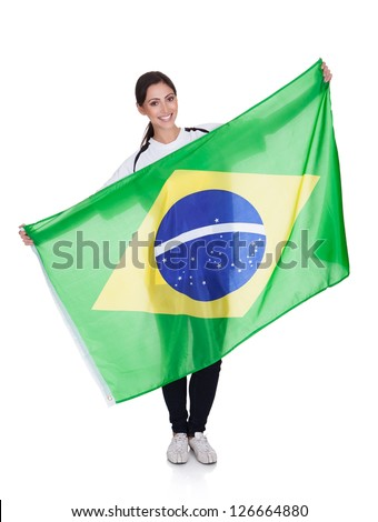 Portrait Of A Happy Pretty Woman Holding Brazilian Flag. Isolated On White