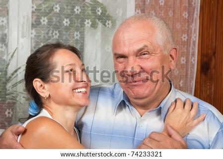 Portrait of a happy romantic couple in interior