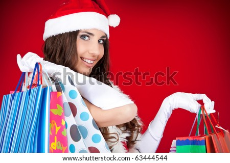 portrait of a happy santa woman with shopping bags
