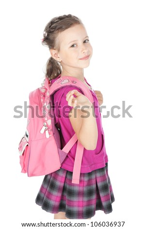 Portrait of a happy schoolgirl with pink backpack over white