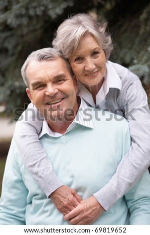 Portrait of a happy senior couple embracing - stock photo