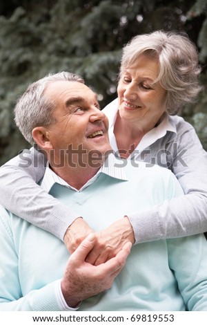 Portrait of a happy senior couple embracing and looking at each other