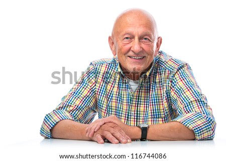 Portrait of a happy senior man smiling isolated on white