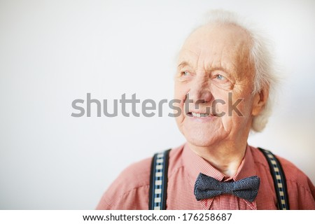 Portrait of a happy senior well-dressed man in isolation