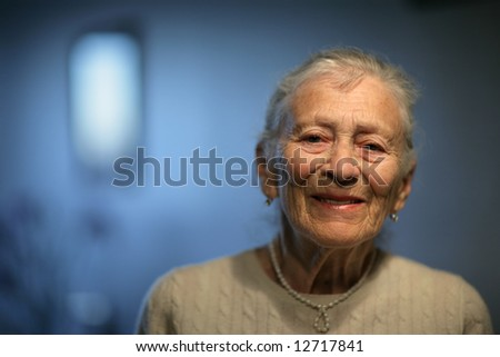Portrait of a happy senior woman at home - stock photo