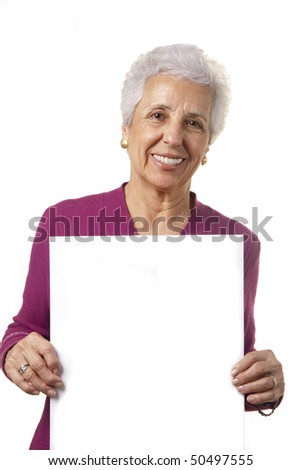 Portrait of a happy senior woman holding blank billboard against white background