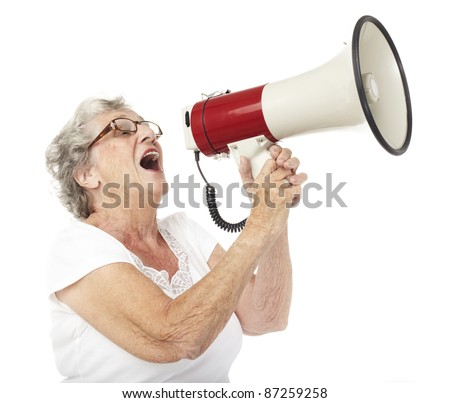 portrait of a happy senior woman shouting with megaphone over white background