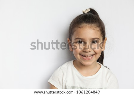 Portrait of a happy smiling child girl