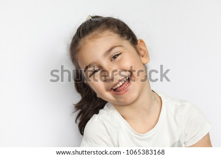 Portrait of a happy smiling child girl #1065383168