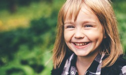 Portrait of a happy smiling child girl. Laughing child. Expressive facial expressions. Black and white image. Space for text.