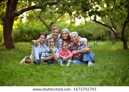 Portrait of a happy smiling family relaxing in park