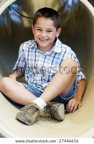 Portrait of a happy smiling little boy playing outside in park