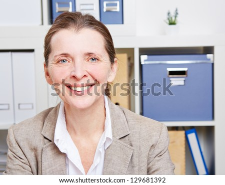 Portrait of a happy smiling senior business woman in her office