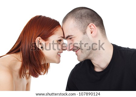 Portrait of a happy, smiling young couple,their nose touching the others` - isolated on white - stock photo