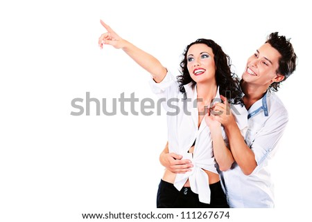 Portrait of a happy smiling young people showing on something. Isolated over white.