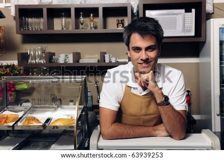 portrait of a happy waiter or owner at the cafe
