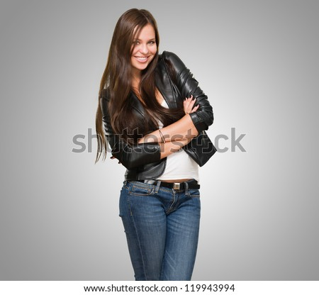Portrait Of A Happy Woman against a grey background