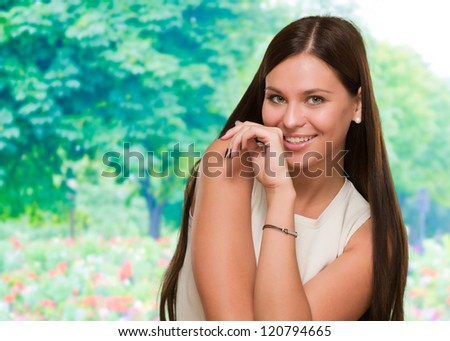 Portrait Of A Happy Woman against a nature background