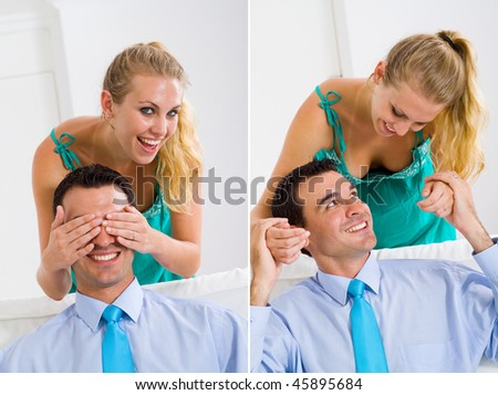 Portrait of a happy woman covering her boyfriend's eyes to surprise him