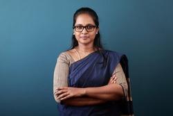 Portrait of a happy woman of Indian origin wearing sari