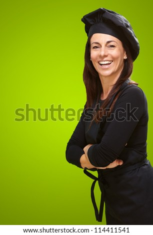 Portrait Of A Happy Woman On Green Background