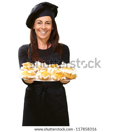 Portrait Of A Happy Woman While Holding Cupcake On White Background