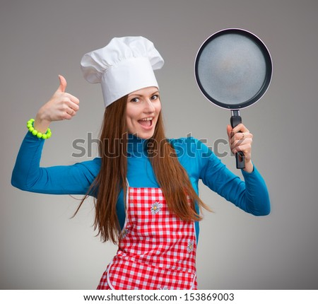 Portrait of a happy woman with the pan