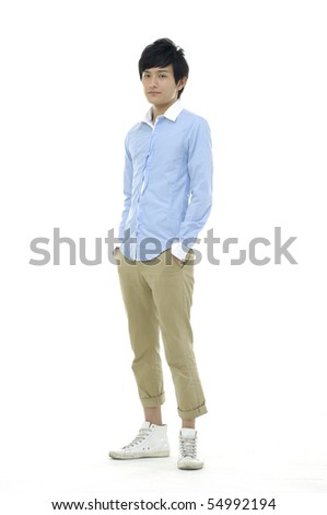 Portrait of a happy young boy standing against isolated