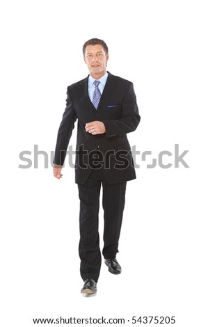 Portrait of a happy young business man carrying a suitcase on white background