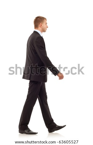 Portrait of a happy young business man walking on white background