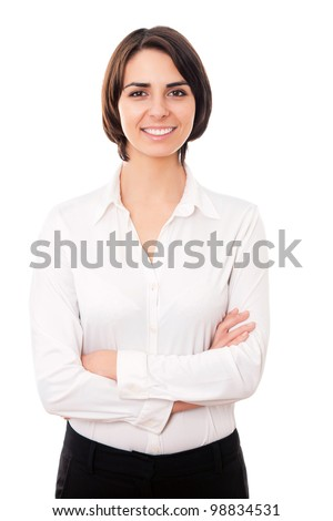 Portrait of a happy young business woman pointing at something interesting against white background