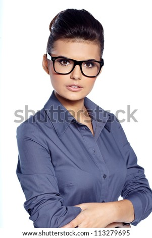 Portrait of a happy young business woman standing  against white background