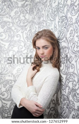 Portrait of a happy young business woman standing with white background