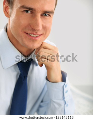 Portrait of a happy young businessman, isolated on white background