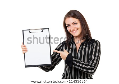 Portrait of a happy young businesswoman pointing at a clipboard, isolated on white background