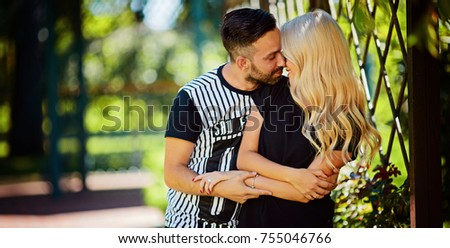 Portrait of a happy young couple enjoying a day in the park together, valentine day