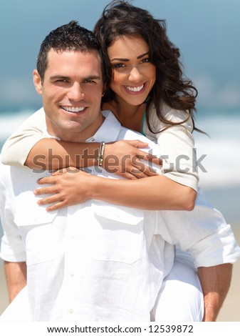 stock photo : Portrait of a happy young couple having fun on the beach. Couple enjoying a summer vacation.