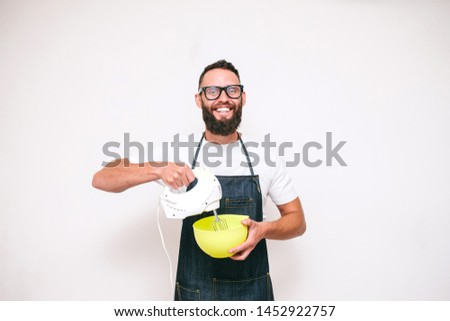 Portrait of a happy young crazy emotional chef cook isolated on a white background