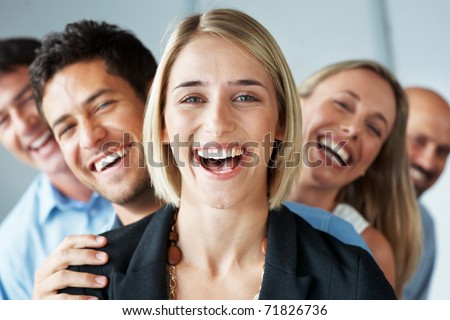 stock photo : Portrait of a happy young female business leader stading in front of her team