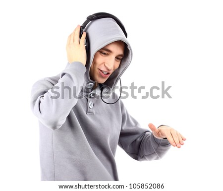 Portrait of a happy young man listen music with headphones