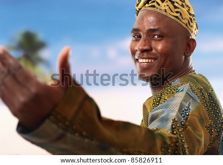 Portrait of a happy young man smiling against the sky