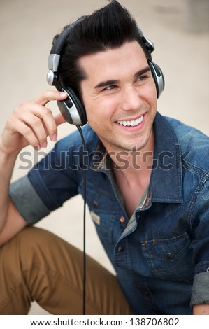 Portrait of a happy young man smiling with headphones