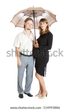 Portrait of a happy young pregnant woman with her husband