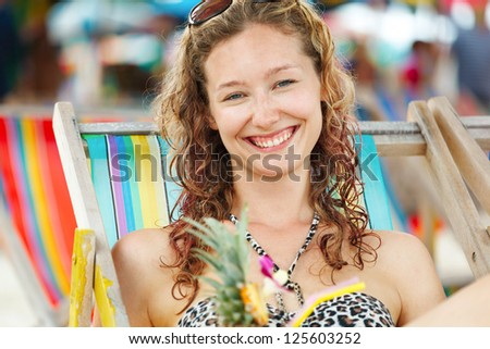 Portrait of a happy young woman posing while on the beach