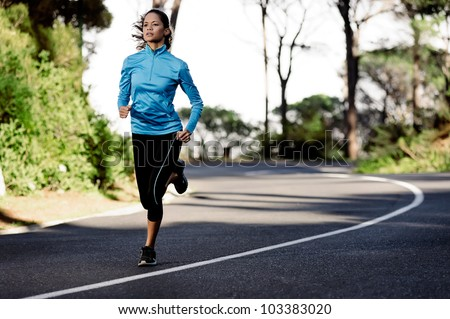portrait of a healthy woman training for running along a mountain road alone. fitness wellness athlete