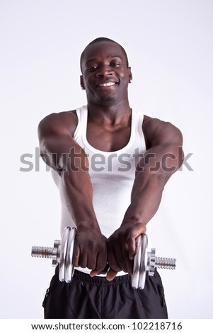 Portrait of a healthy young guy doing exercise - stock photo